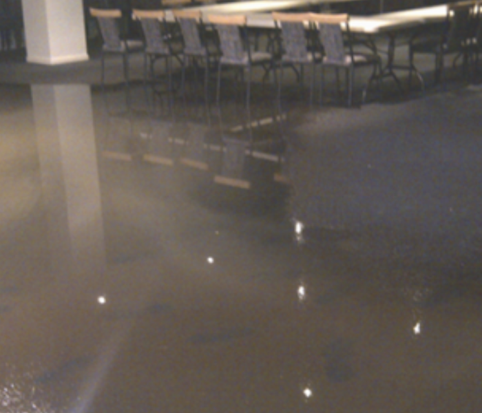 a picture of a commercial lunch room that is flooded with water
