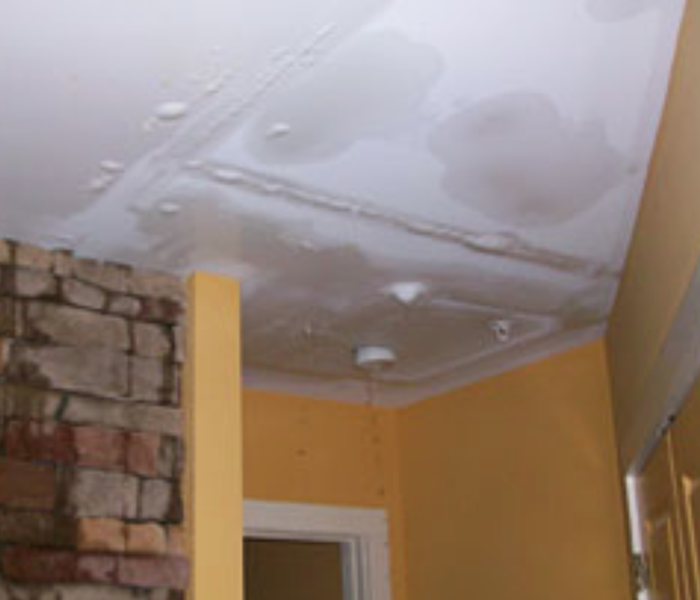 a picture of a ceiling with water damage or bubbling