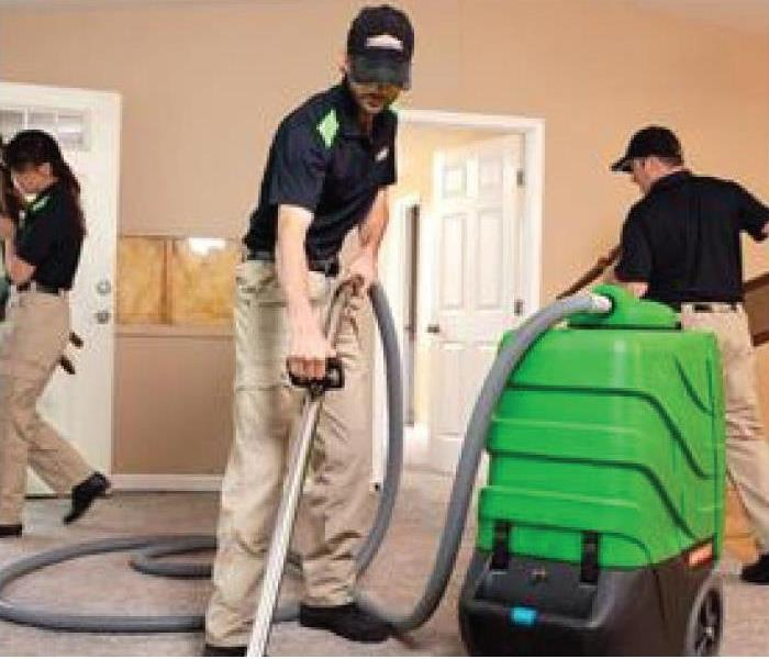 a picture of SERVPRO techs extracting standing water