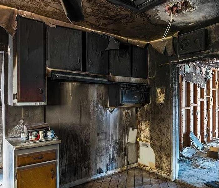 a picture of a room with fire damage